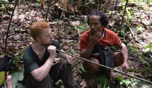 Jon learning how to use a blowpipe from Tok. He's pretty handy with one too.